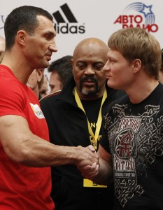 Heavyweight boxing world champion Vladimir Klitschko of Ukraine shakes hands with challenger Alexander Povetkin of Russia during an official weigh-in on the eve of their title fight in Moscow