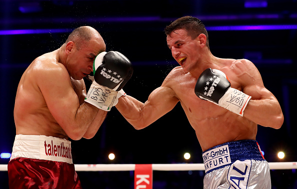 ERFURT, GERMANY - APRIL 22:  Arthur Abraham (L) of Germany and Robin Kraniqi of Germany exchange punches during their WBO super middleweight elimination fight at Messehalle Erfurt on April 22, 2017 in Erfurt, Germany.  (Photo by Martin Rose/Bongarts/Getty Images)